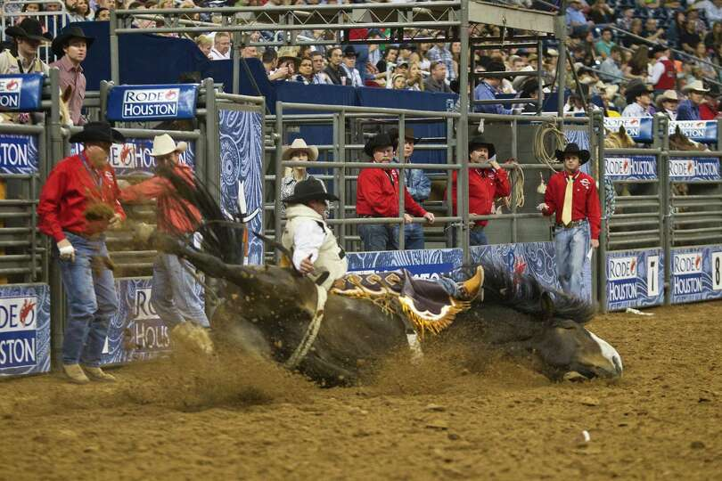 Cody Demers' horse falls during the BP Super Series Wildcard Bareback Riding competition at Reliant