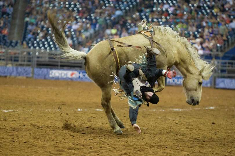 Seth Hardwic competes in BP Super Series Wildcard Bareback Riding competition at Reliant Stadium on