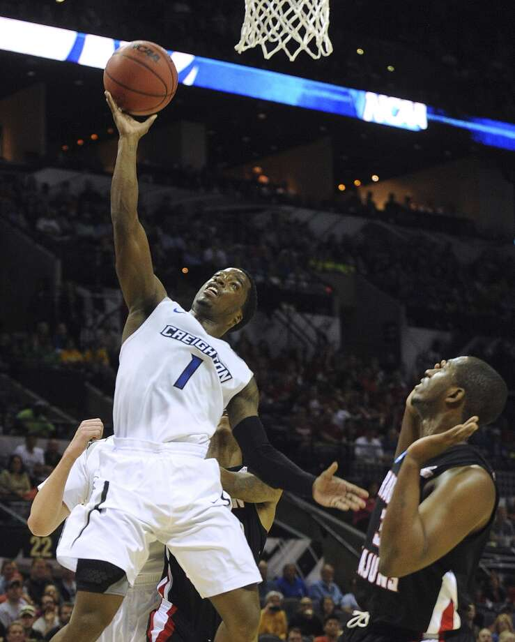 Creighton's Austin Chatman (01) shoots against Louisiana-Lafayette during second-round NCAA tournament first-half action in the AT&T Center on Friday, March 21, 2014. Photo: Billy Calzada, San Antonio Express-News