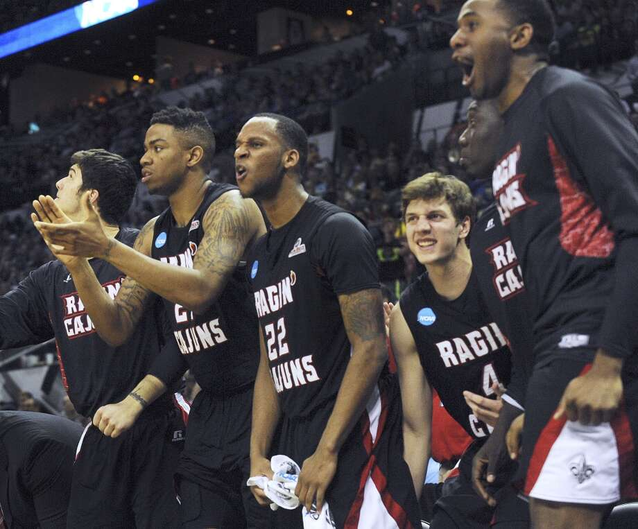 The Louisiana-Lafayette Ragin' Cajuns bench reacts during second-round NCAA tournament second-half action against Creighton in the AT&T Center on Friday, March 21, 2014. Photo: Billy Calzada, San Antonio Express-News