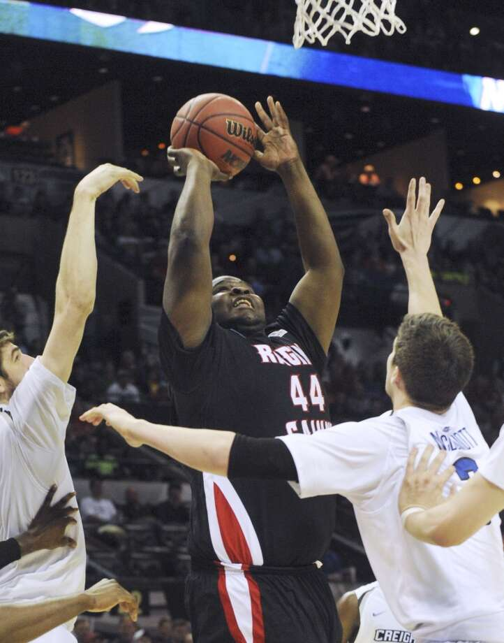 Lousiana-Lafayette's J.J. Davenport (44) shoots and scores from inside during second-round NCAA tournament second-half action against Creighton in the AT&T Center on Friday, March 21, 2014. Photo: Billy Calzada, San Antonio Express-News