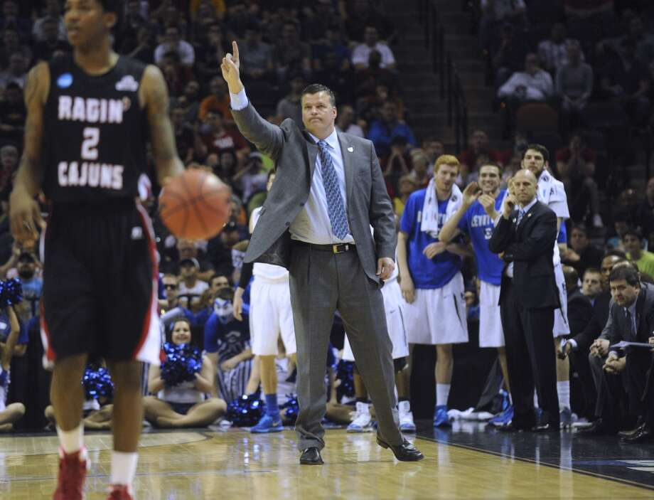 Creighton coach Greg McDermott signals to his team during second-round NCAA tournament action against Louisiana-Lafayette in the AT&T Center on Friday, March 21, 2014. Photo: Billy Calzada, San Antonio Express-News