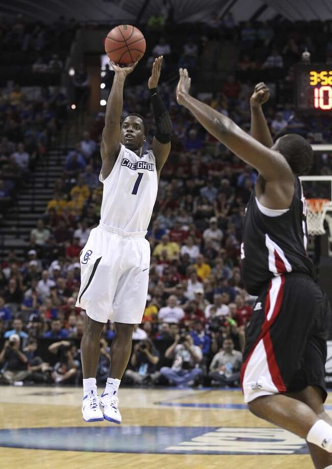 Creighton's Austin Chatman (01) shoots a three-pointer against Louisiana-LaFayette in the second half of the second round of the 2014 NCAA Basketball Championship at the AT&T Center on Friday, March 21, 2014. Creighton moves onto the third round defeating Louisiana-LaFayette, 76-66. Photo: Kin Man Hui, San Antonio Express-News