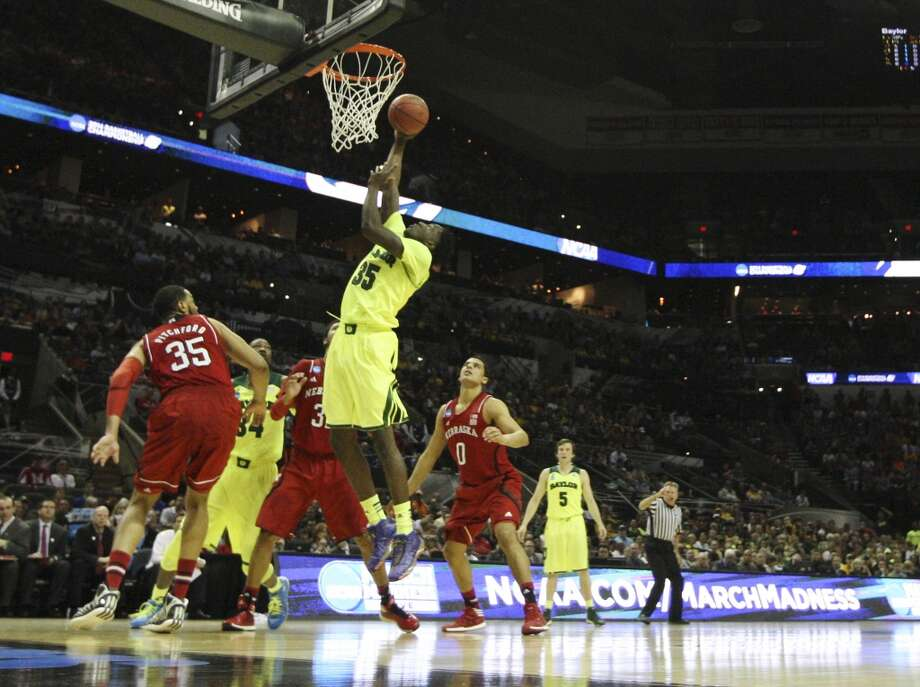 Warren High School graduate and Baylor's Taurean Prince (35) goes up for shot  against Nebraska in the first half of the second round of the 2014 NCAA Basketball Championship at the AT&T Center on Friday, March 21, 2014. Photo: Kin Man Hui, San Antonio Express-News