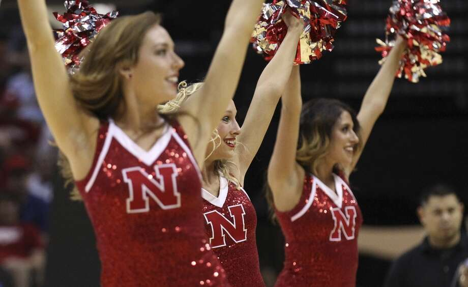 Nebraska cheerleaders perform during a timeout in the first half of the second round of the 2014 NCAA Basketball Championship at the AT&T Center on Friday, March 21, 2014. Photo: Kin Man Hui, San Antonio Express-News