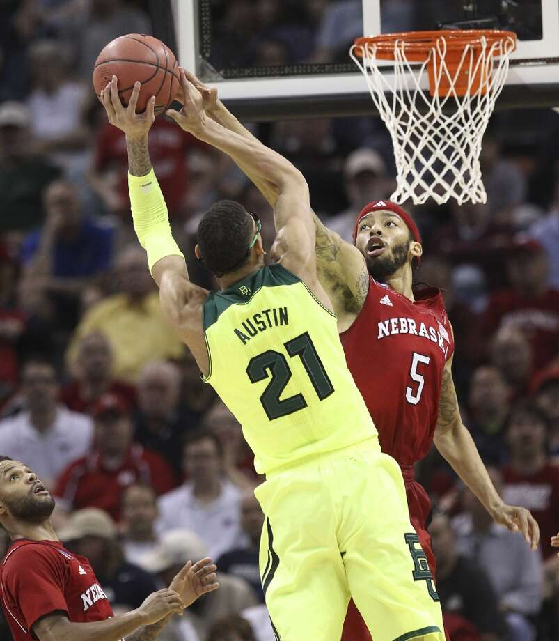 Nebraska'sTerran Petteway (05) commits a could against Baylor's Isaiah Austin (21) in the second half of the second round of the 2014 NCAA Basketball Championship at the AT&T Center on Friday, March 21, 2014. Baylor defeated Nebraska, 74-60, to move onto the third round. Photo: Kin Man Hui, San Antonio Express-News