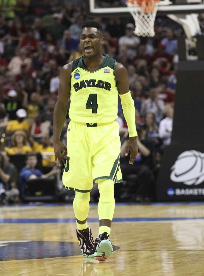 Baylor's Gary Franklin (04) reacts after hitting a shot against Nebraska in the first half of the second round of the 2014 NCAA Basketball Championship at the AT&T Center on Friday, March 21, 2014. Photo: Kin Man Hui, San Antonio Express-News