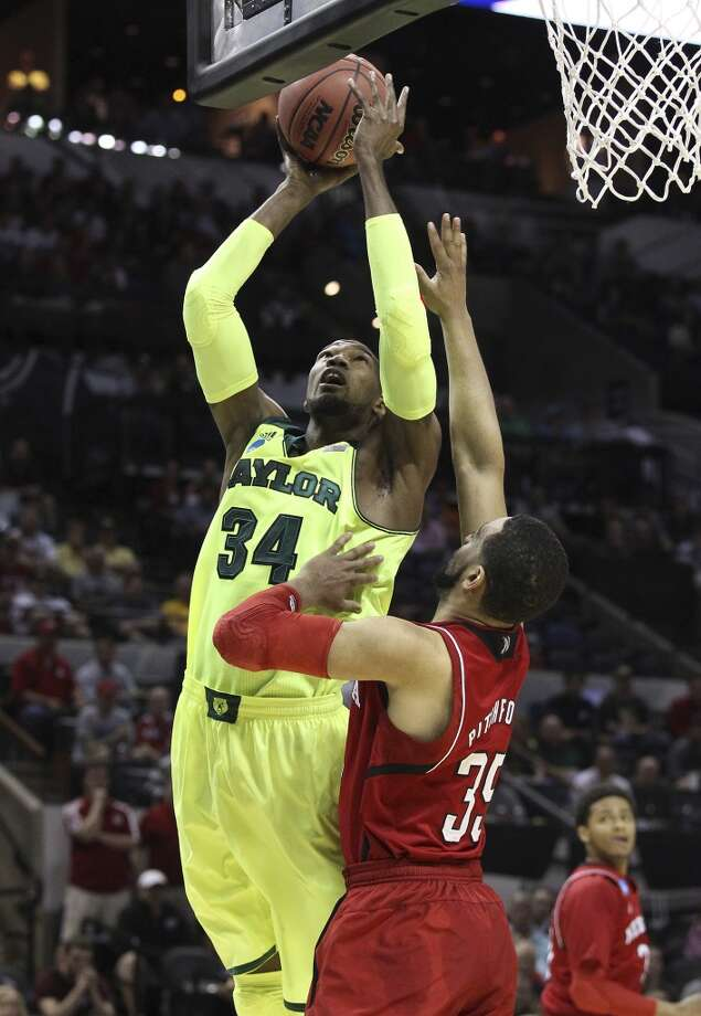 Baylor's Cory Jefferson (34) takes a shot against Nebraska's Walter Pitchford (35) in the first half of the second round of the 2014 NCAA Basketball Championship at the AT&T Center on Friday, March 21, 2014. Photo: Kin Man Hui, San Antonio Express-News