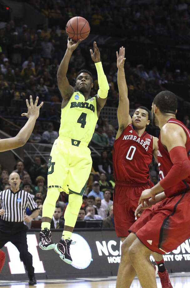 Baylor's Gary Franklin (04) shoots over Nebraska's Tai Webster (00) in the first half of the second round of the 2014 NCAA Basketball Championship at the AT&T Center on Friday, March 21, 2014. Photo: Kin Man Hui, San Antonio Express-News