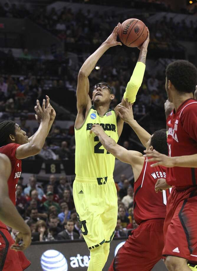 Baylor's Isaiah Austin (21) attempts a shot against Nebraska in the first half of the second round of the 2014 NCAA Basketball Championship at the AT&T Center on Friday, March 21, 2014. Photo: Kin Man Hui, San Antonio Express-News