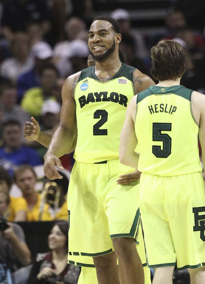 Baylor's Rico Gathers (02) reacts after a play against Nebraska in the second half of the second round of the 2014 NCAA Basketball Championship at the AT&T Center on Friday, March 21, 2014. Baylor defeated Nebraska, 74-60, to move onto the third round. Photo: Kin Man Hui, San Antonio Express-News