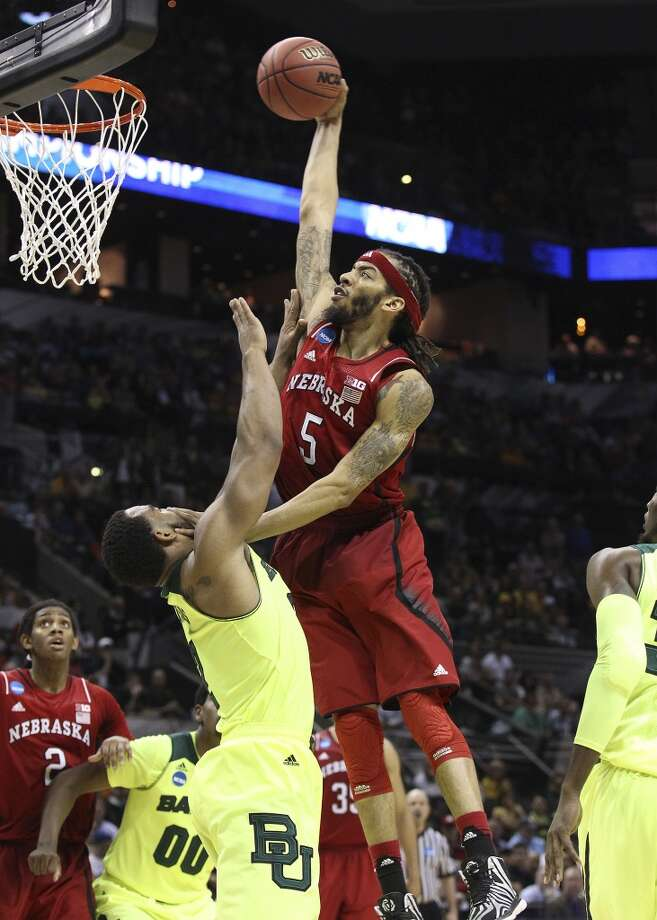 Nebraska'sTerran Petteway (05) goes in for a dunk against Baylor's Rico Gathers (02) in the second half of the second round of the 2014 NCAA Basketball Championship at the AT&T Center on Friday, March 21, 2014. Baylor defeated Nebraska, 74-60, to move onto the third round. Photo: Kin Man Hui, San Antonio Express-News