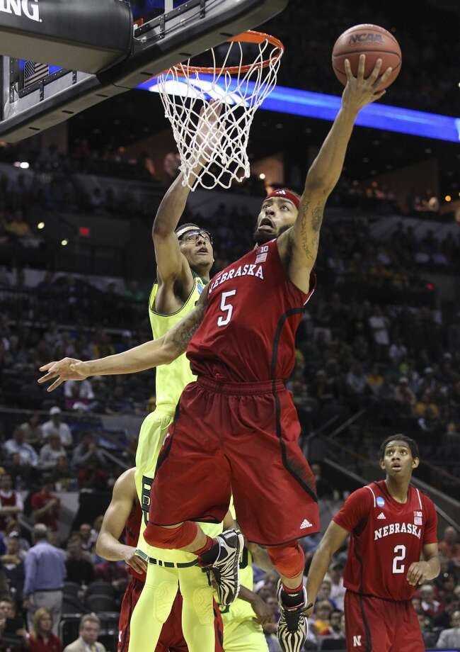Nebraska'sTerran Petteway (05) attempts a layup against Baylor's Isaiah Austin (21) in the second half of the second round of the 2014 NCAA Basketball Championship at the AT&T Center on Friday, March 21, 2014. Baylor defeated Nebraska, 74-60, to move onto the third round. Photo: Kin Man Hui, San Antonio Express-News
