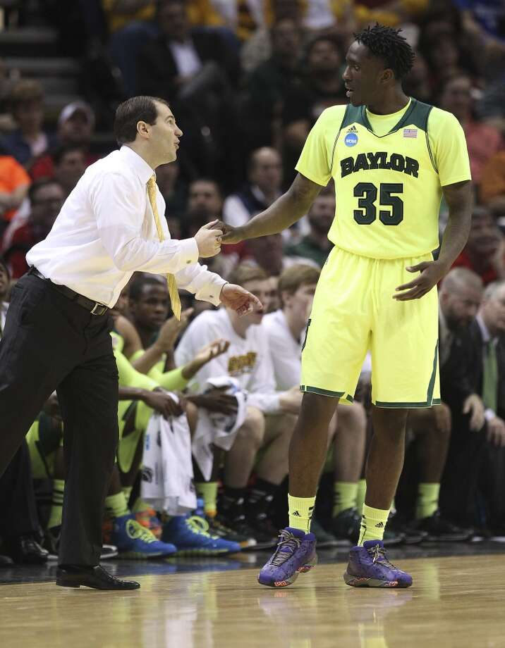 Warren High School graduate and Baylor's Taurean Prince (35) gets instruction from coach Scott Drew in the second half of the second round of the 2014 NCAA Basketball Championship at the AT&T Center on Friday, March 21, 2014. Baylor defeated Nebraska, 74-60, to move onto the third round. Photo: Kin Man Hui, San Antonio Express-News