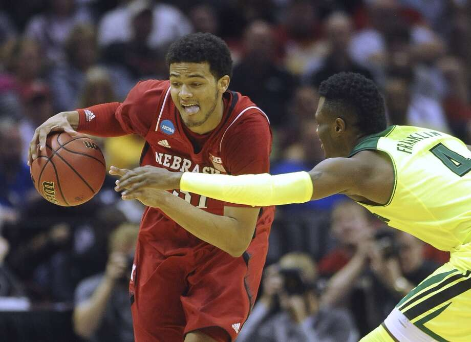 Nebraska's Shavon Shields (31) dribbles the ball as Baylor's Gary Franklin (04) attempts to steal during second-round NCAA tournament action in the AT&T Center on Friday, March 21, 2014. Photo: Billy Calzada, San Antonio Express-News