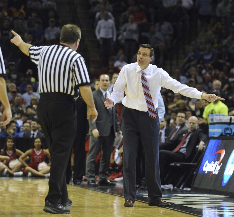 Nebraska coach Ken Miles is ejected during second-round NCAA tournament second-half action against Baylor in the AT&T Center on Friday, March 21, 2014. Photo: Billy Calzada, San Antonio Express-News