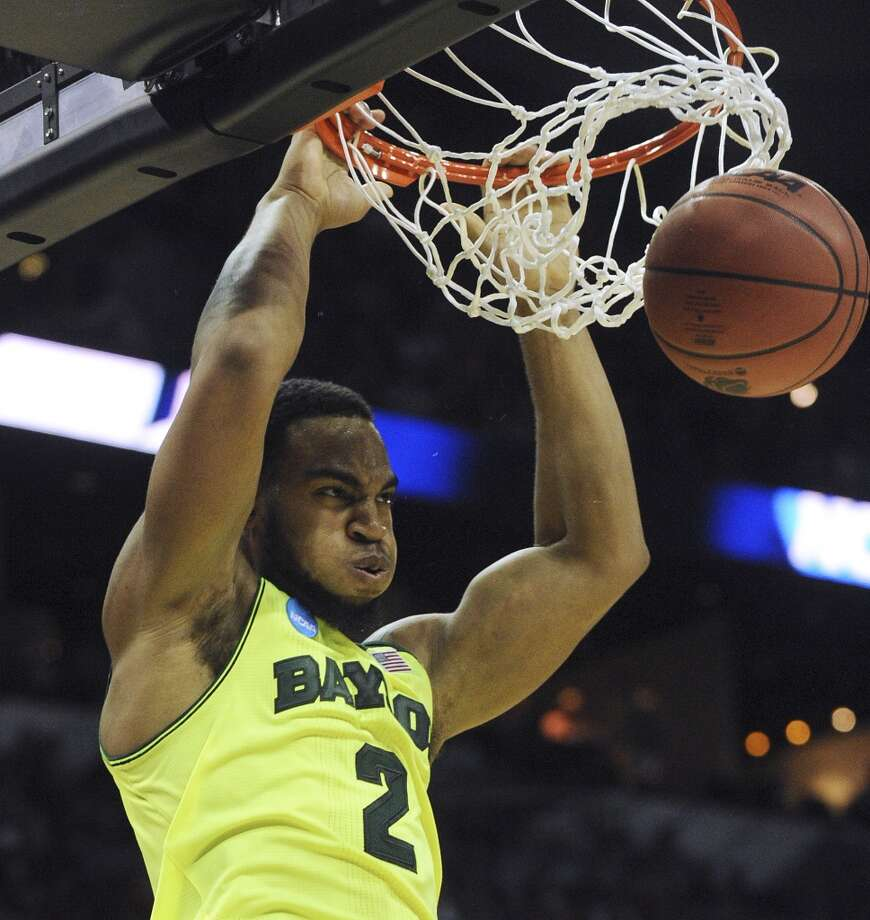 Baylor's Rico Gathers (2) dunks against Nebraska during second-round NCAA tournament second-half action in the AT&T Center on Friday, March 21, 2014. Photo: Billy Calzada, San Antonio Express-News