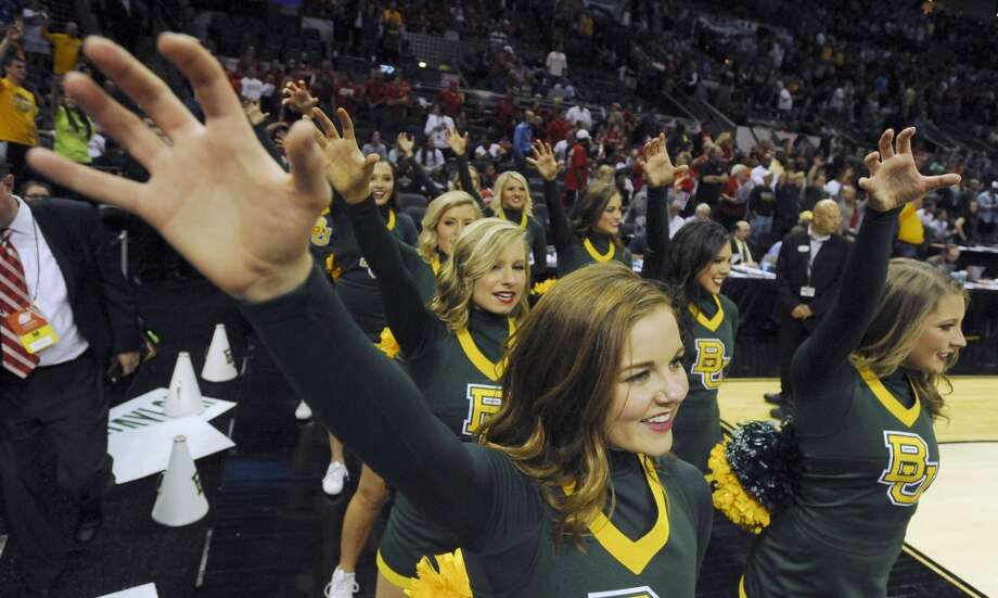 The Baylor Bears cheerleaders celebrate after defeating Nebraska in the NCAA tournament on Friday, March 21, 2014. Photo: Billy Calzada, San Antonio Express-News