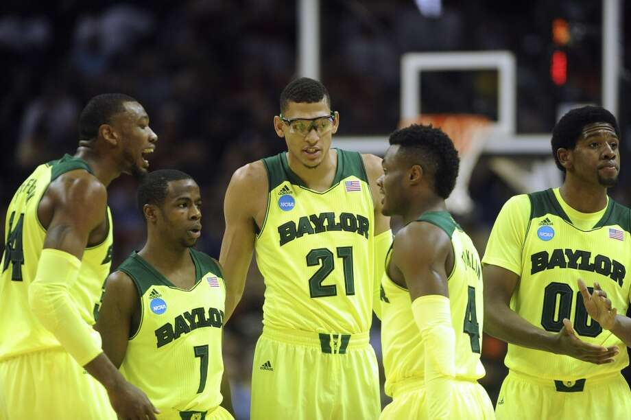 Baylor's Cory Jefferson (34), left, Kenny Chery (01), Isaiah Austin (21), Gary Franklin (04) and Royce O'Neale (00) gather on the court during second-round NCAA tournament action against Nebraska in the AT&T Center on Friday, March 21, 2014. Photo: Billy Calzada, San Antonio Express-News
