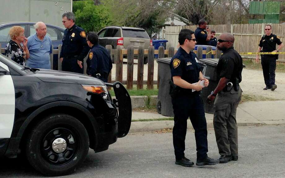 Police investigate a Southwest Side home Friday where a woman and her 3-year-old son were found shot to death. Photo: Alia Malik / San Antonio Express-News / © 2014 San Antonio Express-News