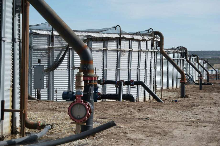 Houston-based Apache Corp. employs re-engineered grain bins to treat produced water   which emerges from wells along with oil and gas -- before recycling it for use in hydraulic fracturing of Wolfcamp Shale wells in the Barnhart area in Irion County, Texas. Photo: Apache Corp. / Gaylon Wampler Photography 719-930-6232