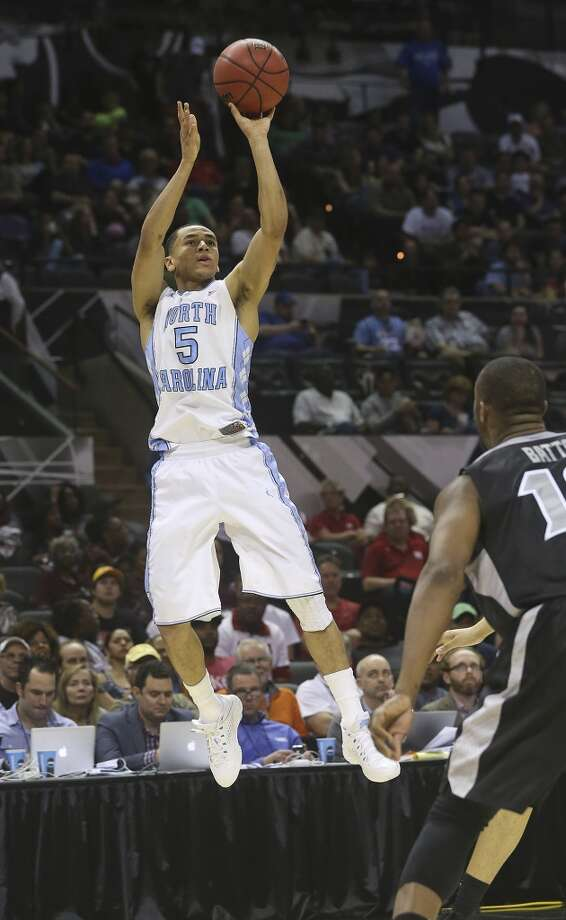 Marcus Paige pumps a three pointer for the Tar Heels in the second half as Providence plays North Carolina in the second round of the 2014 NCAA Division I Men's Basketball Championship at the AT&T Center on Friday, March 21, 2014. Photo: Tom Reel, San Antonio Express-News