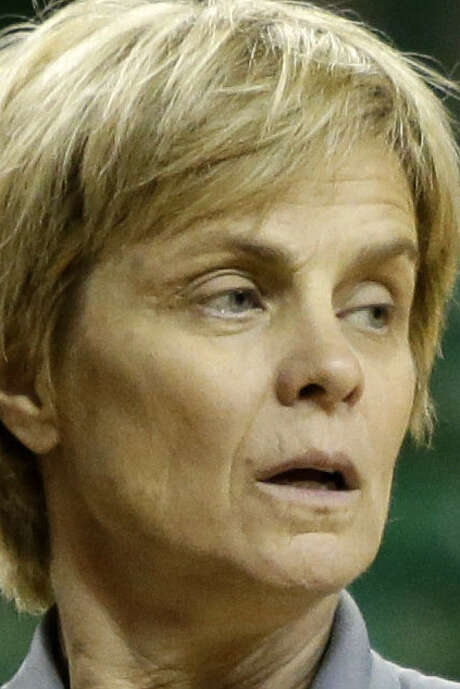 Kim Mulkey is suspended for her actions vs. Louisville last year. / AP