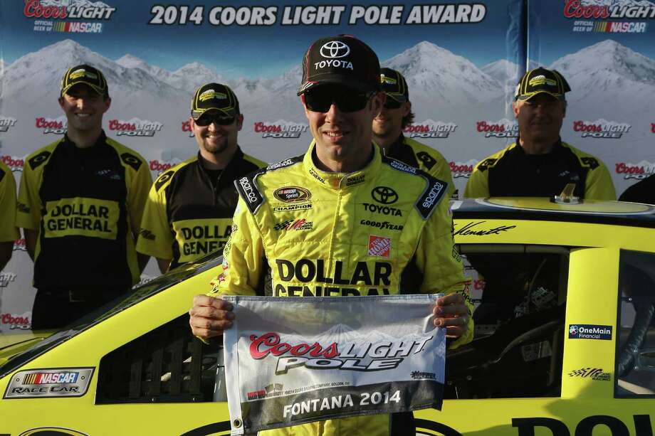 FONTANA, CA - MARCH 21:  Matt Kenseth, driver of the #20 Dollar General Toyota, celebrates setting the pole position in qualifying for the NASCAR Sprint Cup Series Auto Club 400 at Auto Club Speedway on March 21, 2014 in Fontana, California.  (Photo by Todd Warshaw/Getty Images) ORG XMIT: 479905905 Photo: Todd Warshaw / 2014 Getty Images