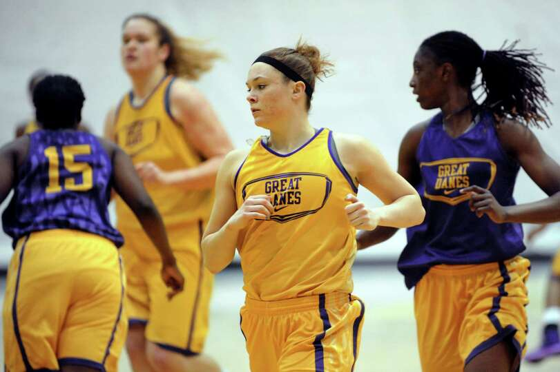 UAlbany junior guard Sarah Royals, center, runs drills with her team as they prepare for their NCAA