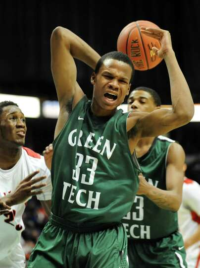 Green Tech's Anquan McClean, center, can't hang on to a rebound during their Federation Class AA bas