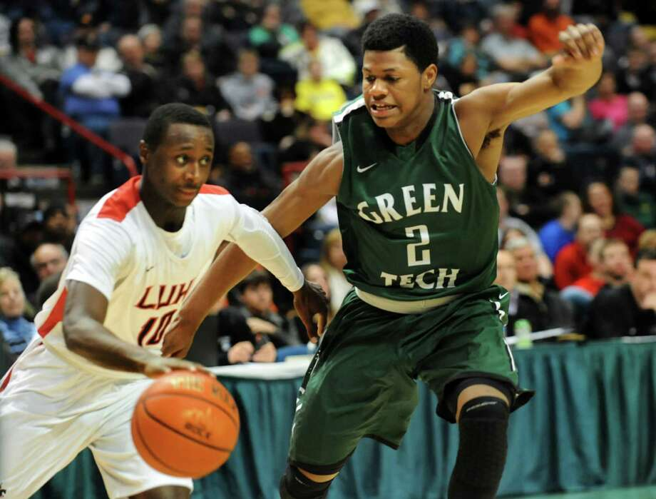 Green Tech's Najee Ward, right, defends against Long Island Lutheran's Chris Atkinson during their Federation Class AA basketball semifinal on Friday, March 21, 2014, at Times Union Center in Albany, N.Y. (Cindy Schultz / Times Union) Photo: Cindy Schultz / 00026203A