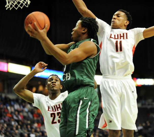 Green Tech's Isiah Dobere, center, goes to the hoop as Long Island Lutheran's Marvin Prochet, left,