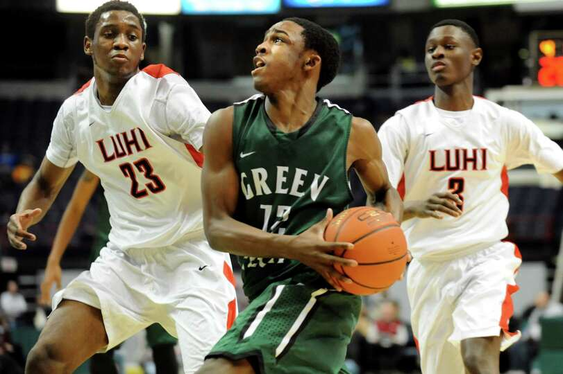 Green Tech's Jamil Hood Jr., center, looks to the hoop as Long Island Lutheran's Marvin Prochet, lef