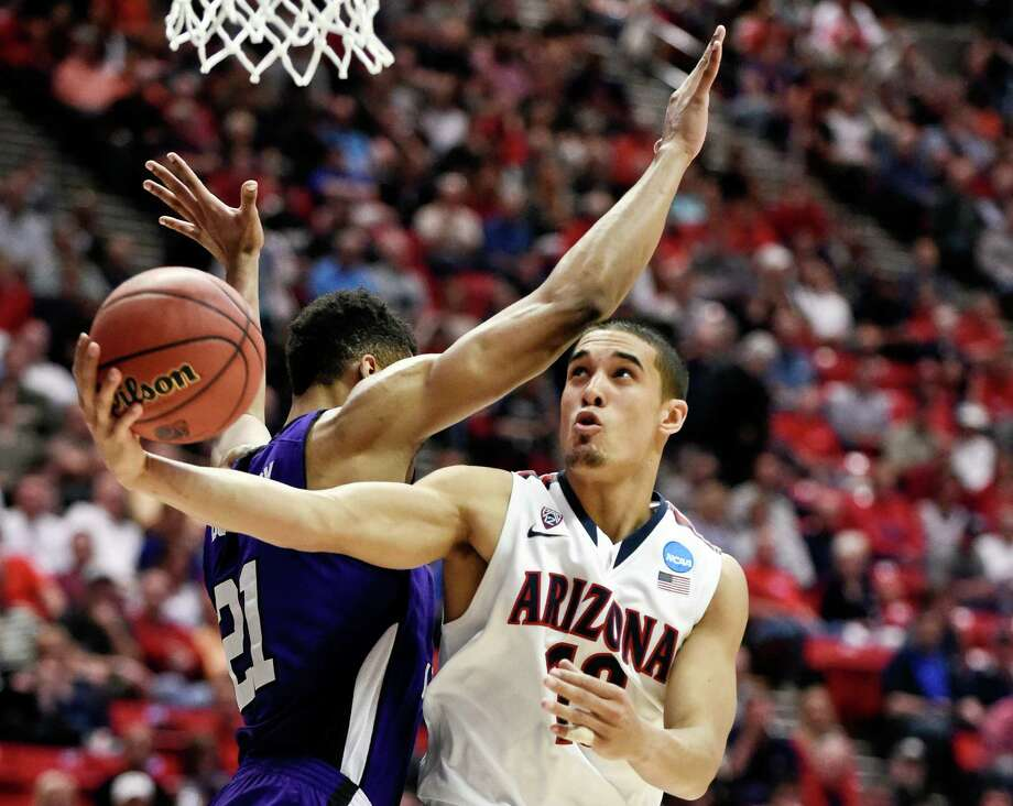 Arizona's Nick Johnson gets a shot off under the arm of Weber State's Joel Bolomboy during the second half in a second-round game in the NCAA college basketball tournament Friday, March 21, 2014, in San Diego. (AP Photo/Denis Poroy) ORG XMIT: CALI118 Photo: Denis Poroy / FR59680 AP
