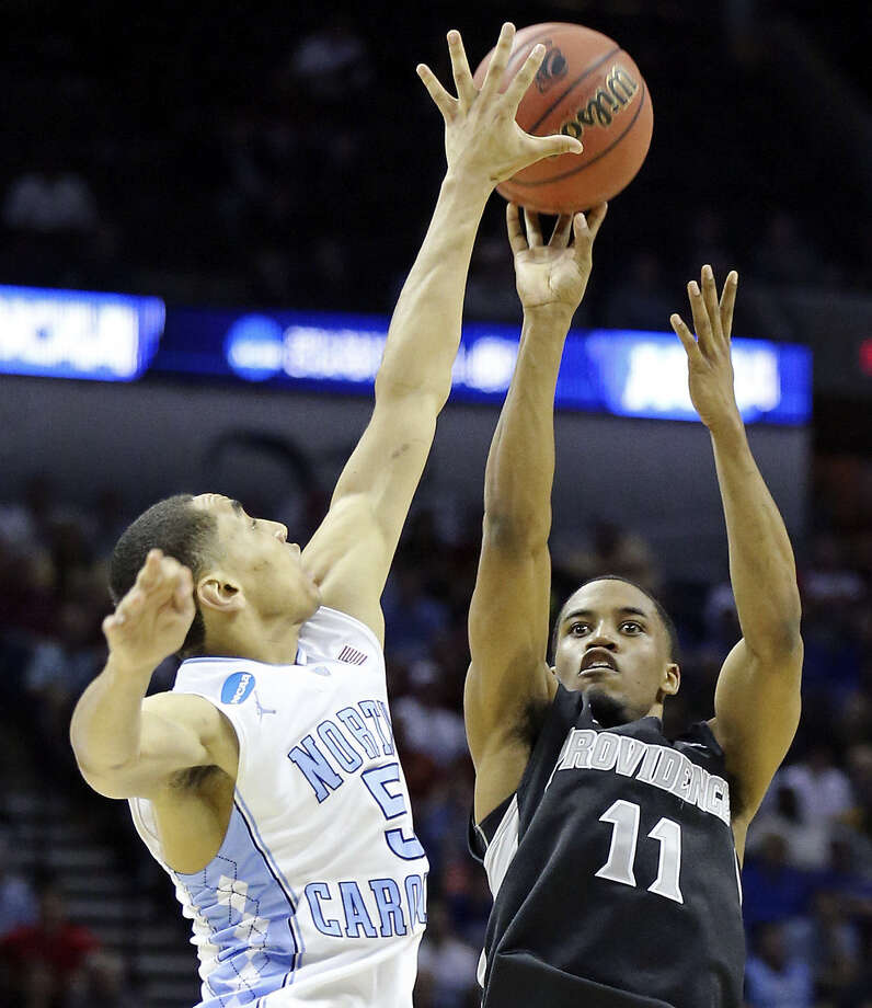 Providence's Bryce Cotton tries to get off a shot against North Carolina's Marcus Paige during the second half. Cotton finished the game with 36 points and eight assists, while Paige contributed 19 points. Photo: Edward A. Ornelas / San Antonio Express-News / © 2014 San Antonio Express-News