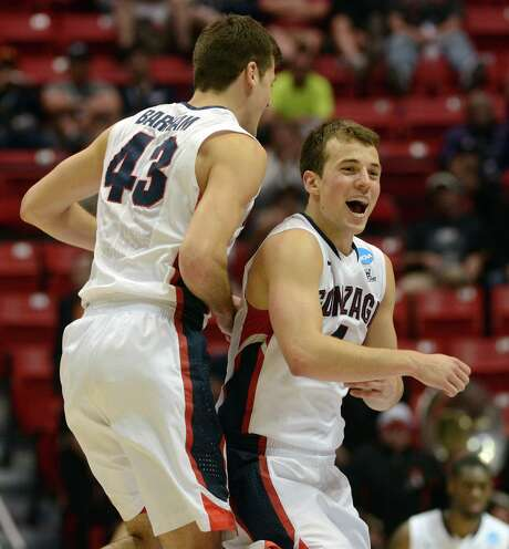 Gonzaga's Kevin Pangos (right) and Drew Barham celebrate their win over OSU. Pangos scored 26 points, going 12 for 14 on free throws. Barham had six points on two 3-pointers. Photo: Donald Miralle / Getty Images / 2014 Getty Images