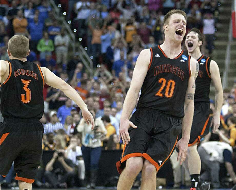 Mercer's Jakob Gollon (20), Kevin Canevari and the rest of the Bears erupt in celebration after beating third-seeded Duke in Raleigh, N.C. Gollon scored 20 points in the upset victory. Photo: Corey Lowenstein / McClatchy-Tribune News Service / Raleigh News & Observer