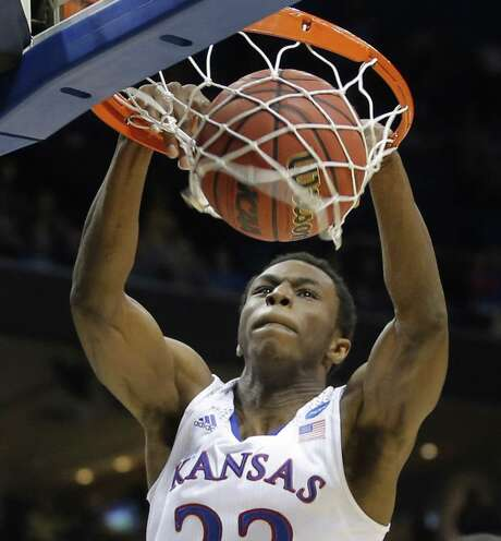Andrew Wiggins dunks for two of his 19 points in No. 2 seed Kansas' victory. The Jayhawks trailed by as many as nine early. Photo: Travis Heying, McClatchy-Tribune News Service / Wichita Eagle