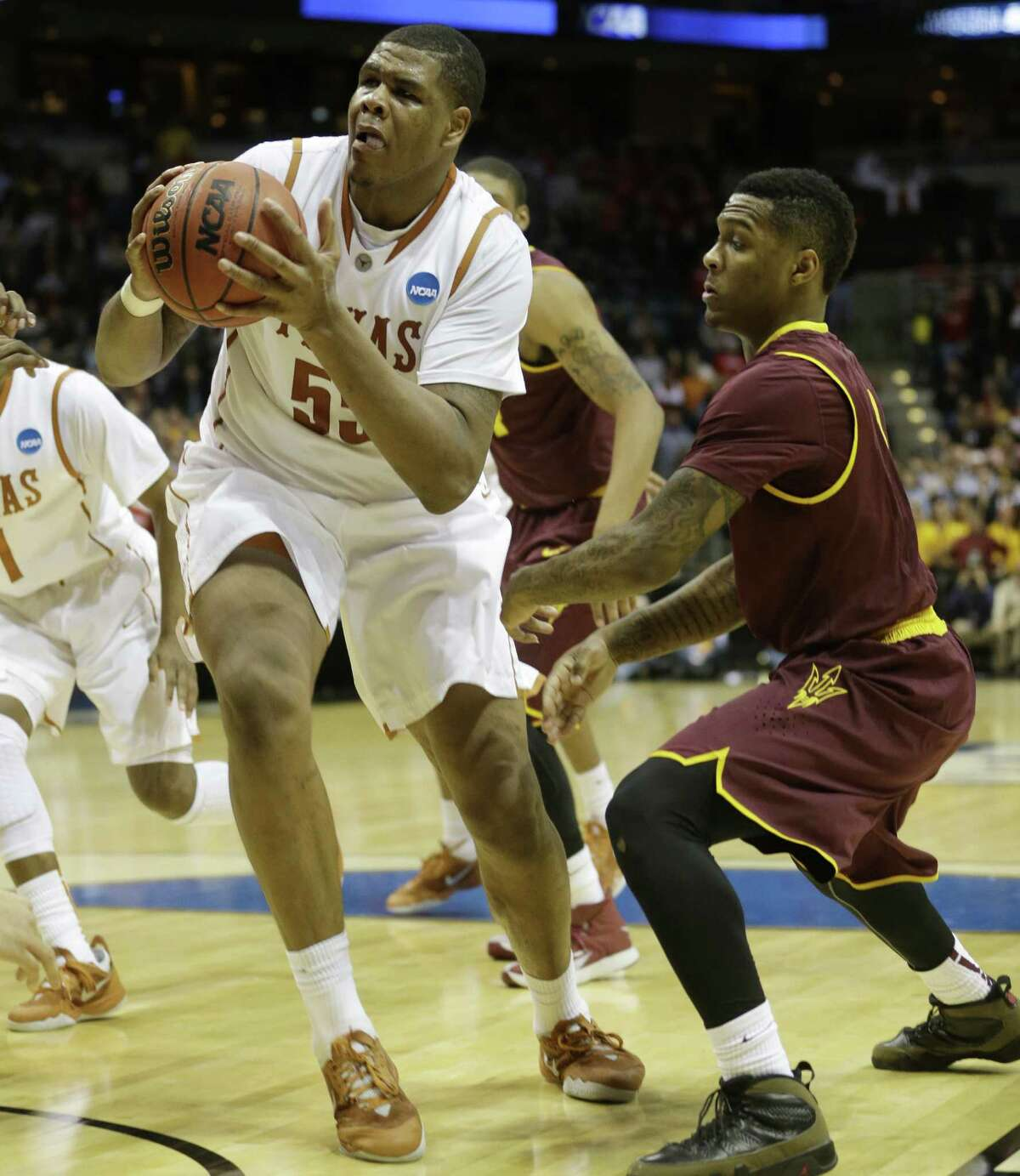 UT sophomore center Cameron Ridley, driving to set up his game-winning basket, had 17 points and 12 rebounds vs. ASU.