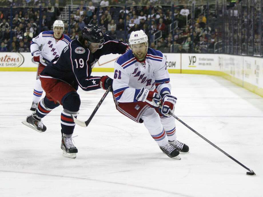 Columbus Blue Jackets' Ryan Johansen (19) checks New York Rangers' Rick Nash (61) during the first period of an NHL hockey game, Friday, March 21, 2014, in Columbus, Ohio. (AP Photo/Mike Munden) ORG XMIT: OHMM102 Photo: Mike Munden / FR57028 AP