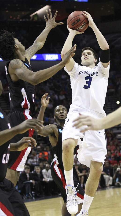 Doug McDermott (right) shoots as Elfrid Payton defends. McDermott led Creighton with 30 points. Payton scored 24. Photo: Kin Man Hui / San Antonio Express-News / ©2013 San Antonio Express-News