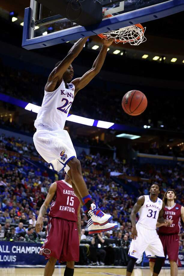 ST LOUIS, MO - MARCH 21:  Andrew Wiggins #22 of the Kansas Jayhawks dunks the ball against the Eastern Kentucky Colonels during the second round of the 2014 NCAA Men's Basketball Tournament at Scottrade Center on March 21, 2014 in St Louis, Missouri.  (Photo by Andy Lyons/Getty Images) ORG XMIT: 459542747 Photo: Andy Lyons / 2014 Getty Images