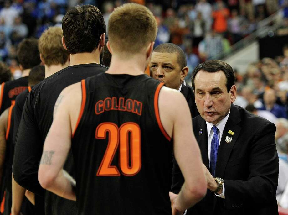 Duke coach Mike Krzyzewski (right), shaking hands with Mercer's players after his Blue Devils were upset in the second round, was complimentary of the Atlantic Sun Conference champion Bears. Photo: Grant Halverson / Getty Images / 2014 Getty Images