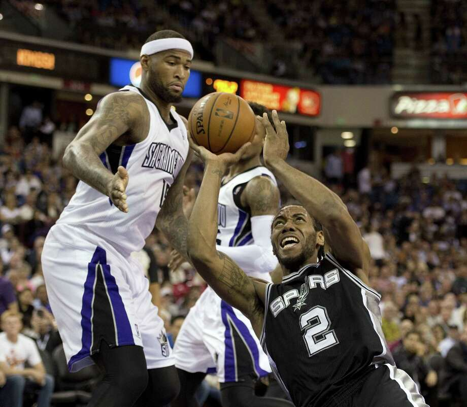 The San Antonio Spurs' Kawhi Leonard (2) is fouled by the Sacramento Kings' Ben McLemore as he puts up a shot in the second quarter at Sleep Train Arena in Sacramento, Calif., on Friday, March 21, 2014. (Jose Luis Villegas/Sacramento Bee/MCT) Photo: Jose Luis Villegas, McClatchy-Tribune News Service / Sacramento Bee