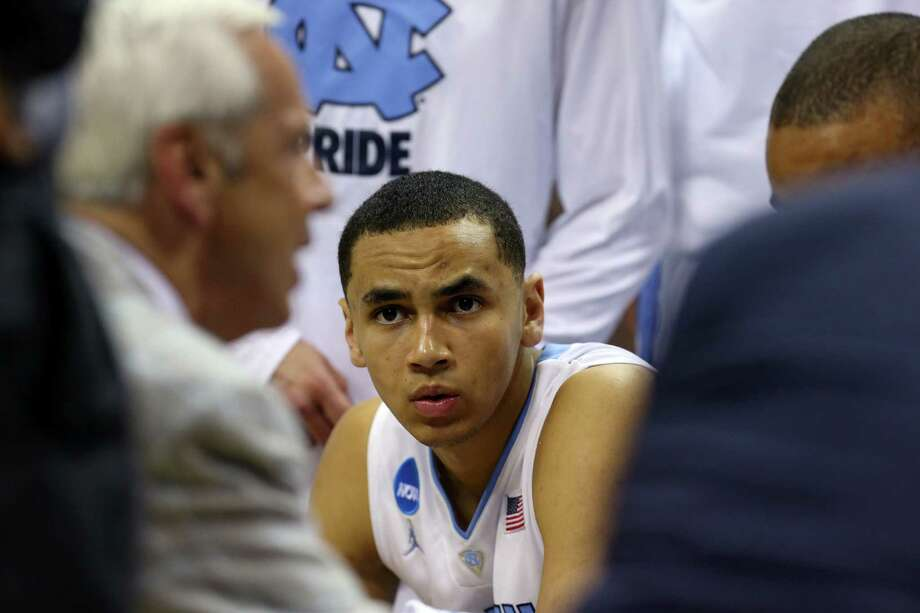 SAN ANTONIO, TX - MARCH 21:  Marcus Paige #5 of the North Carolina Tar Heels looks on during a timeout in the closing moments of the Tar Heels 79-77 win over the Providence Friars during the second round of the 2014 NCAA Men's Basketball Tournament at AT&T Center on March 21, 2014 in San Antonio, Texas.  (Photo by Ronald Martinez/Getty Images) ORG XMIT: 459540679 Photo: Ronald Martinez / 2014 Getty Images