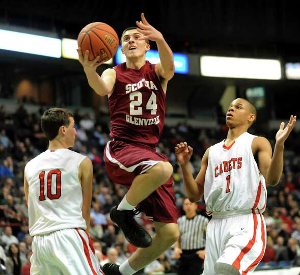 Scotia's Joe Cremo, center, goes to the hoop as Albany Academy's John Moutopoulos, left, and Ray Jer
