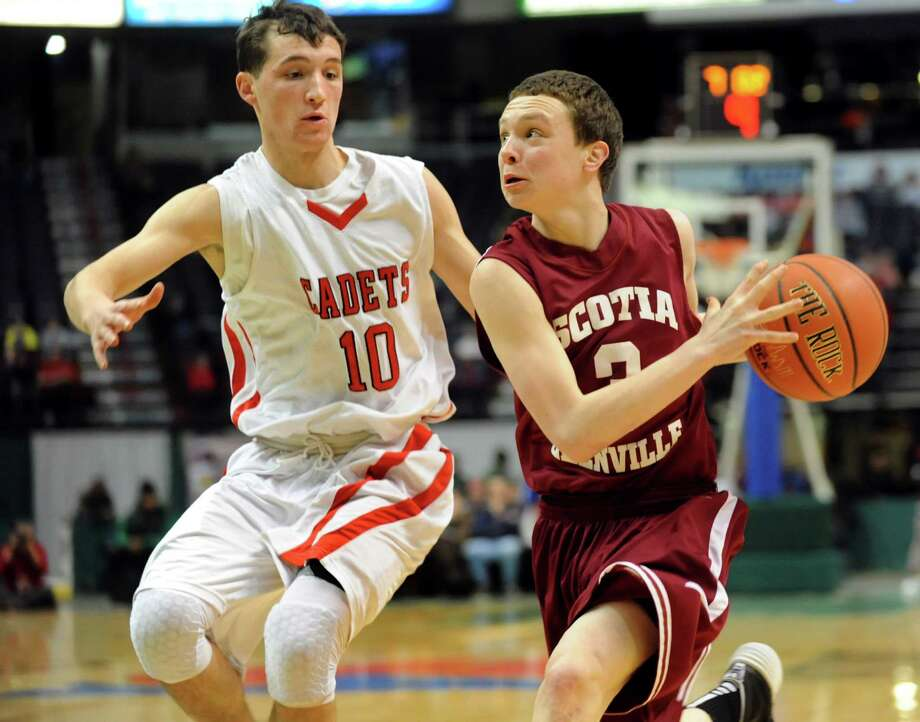 Scotia's Scott Stopera, right, drives to the hoop as Albany Academy's John Moutopoulos defends during their Federation Class A basketball semifinal on Friday, March 21, 2014, at Times Union Center in Albany, N.Y. (Cindy Schultz / Times Union) Photo: Cindy Schultz / 00026202A