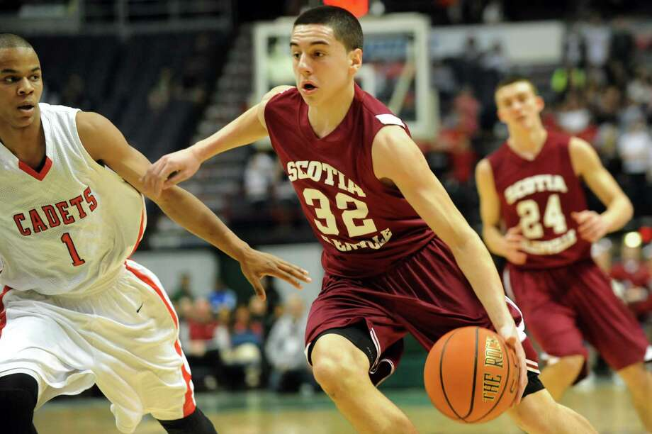 Scotia's Dom Lemorta, center, controls the ball as Albany Academy's Ray Jerome, left, defends during their Federation Class A basketball semifinal on Friday, March 21, 2014, at Times Union Center in Albany, N.Y. (Cindy Schultz / Times Union) Photo: Cindy Schultz / 00026202A