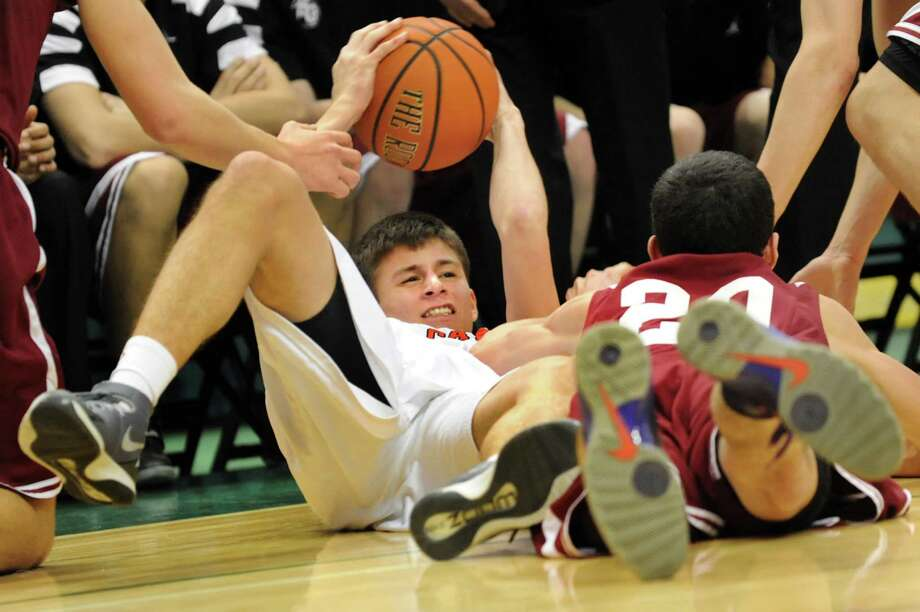 Albany Academy's Sal Arena, center, comes up with the ball in a scramble with Scotia's Mike Palleschi during their Federation Class A basketball semifinal on Friday, March 21, 2014, at Times Union Center in Albany, N.Y. (Cindy Schultz / Times Union) Photo: Cindy Schultz / 00026202A