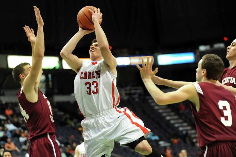 Albany Academy's Teigue Donohoe, center, goes to the hoop during their Federation Class A basketball semifinal against Scotia on Friday, March 21, 2014, at Times Union Center in Albany, N.Y. (Cindy Schultz / Times Union) Photo: Cindy Schultz / 00026202A